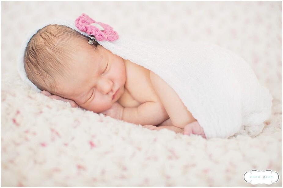 A swaddled newborn during her Houston Newborn Portraits
